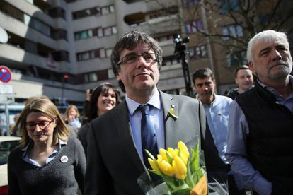 Carles Puigdemont (C) with supporters in Berlin following his release from custody.