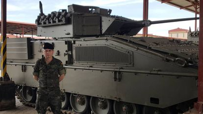 Spanish general Francisco José Dacoba Cerviño in front of a Pizarro combat vehicle.