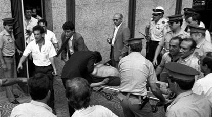 A pregnant woman is carried from the scene of the 1987 Hipercor bombing on a stretcher.