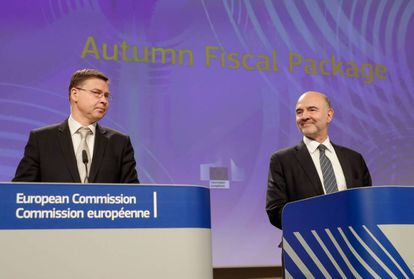 EU Commission Vice-President Valdis Dombrovskis (L) and Pierre Moscovici, the EU Commissioner for Economic and Financial Affairs.