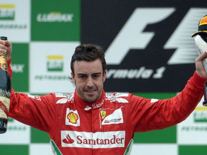 Fernando Alonso celebrates his second place position at the Brazil GP.