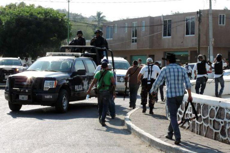 Vigilante groups and police on patrol in Arteaga, Michoacán.