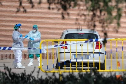 Health workers prepare to administer a fast test in Madrid.