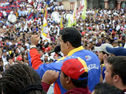 Maduro addresses the crowd from the Miraflores palace.