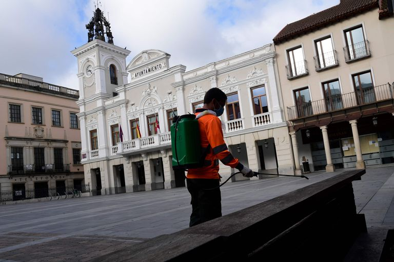 A worker disinfects a square in Guadalajara on Monday.