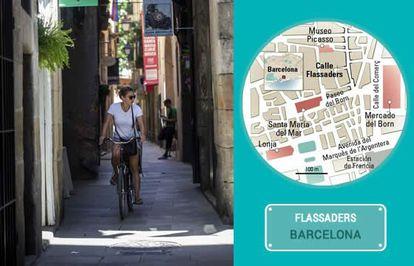 A cyclist on Barcelona's Flassaders street.