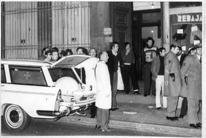 Police and ambulance staff outside the building in Madrid's Atocha street where five lawyers were killed on January 24, 1977.