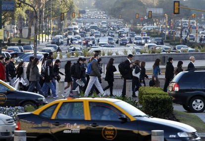 Pedestrians cross Buenos Aires' July 9 Avenue during a metro strike.