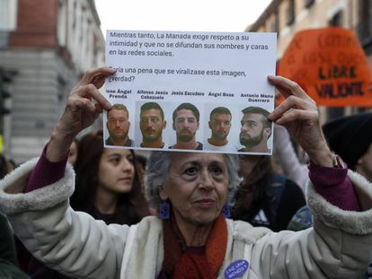 A woman protests outside the Pamplona court where the La Manada trial is taking place.