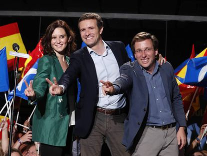 The PP's Madrid regional candidate Isabel Díaz Ayuso, national chief Pablo Casado and Madrid mayoral candidate José Luis Martínez-Almeida celebrate their gains on Sunday night.