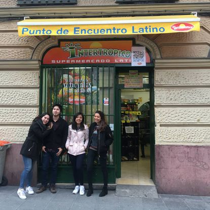Laura and friends from Mexico outside 'Intertropico,' a shop that imports food and products from all of Latin America.