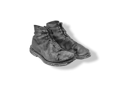 Boots belonging to 19-year-old Perfecto de Dios, who was executed in 1950.