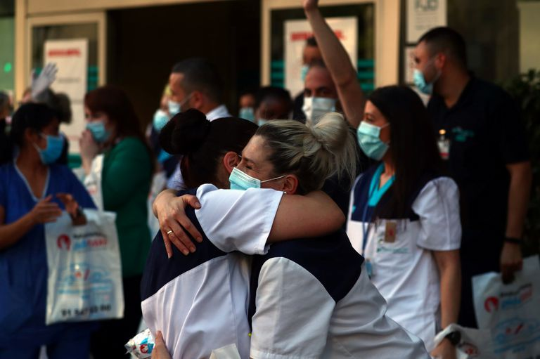 Medical staff from Fundacion Jimenez Diaz hospital embrace each other in Madrid on May 17.