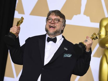 Guillermo del Toro with his two awards.