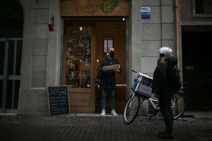 A rider picks up a package at a Barcelona store on November 27.