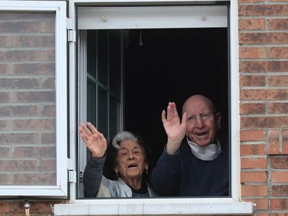 José and Guadalupe, wave from their home, after being discharged from hospital.