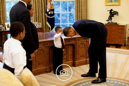 Jacob Philadelphia wanted to know if Obama's hair was like his own. Click on the image to see more photos from his presidency.