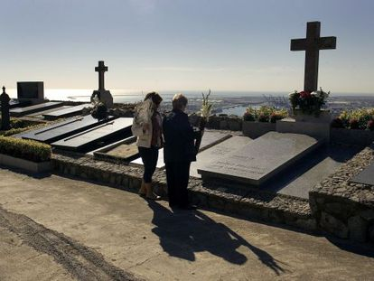 Mourners attend a cemetery on All Saint's day to pay their respects.
