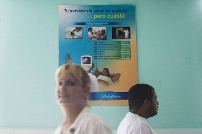 Cuba's health service is free, but as a poster behind this nurse points out, it is expensive.