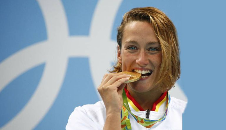 Swimmer Mireia Belmonte with her Olympic gold medal for the 200m butterfly.