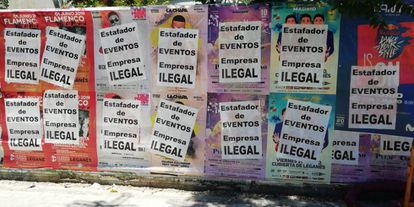 """Posters for music concerts that have been sabotaged. The fly posters that have been stuck on top of them read: """"Fraudulent events. Illegal company."""""""