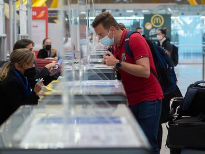 A passenger checks in at Madrid's Barajas Airport in March 2021.