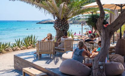 Tourists at a beach in Ibiza.