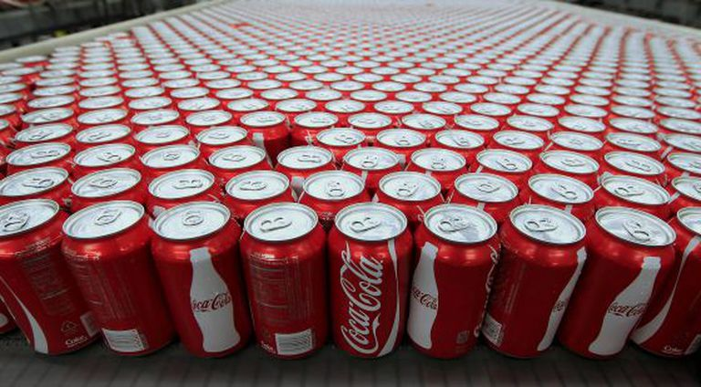 Cans of Coca- Cola Co soda move along a conveyor belt at the company' s Swire bottling plant in Salt Lake City Utah