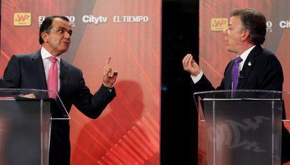 Zuluaga (l) and Santos during the debate.