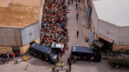 Unaccompanied minors who crossed into Spain outside a warehouse used as temporary shelter in Ceuta on Wednesday.