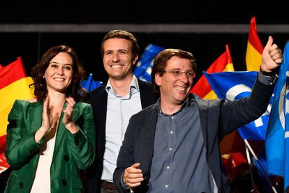 Popular Party leader Pablo Casado (C), celebrates the election results with PP candidate to Madrid's regional government Isabel Diaz Ayuso (l) and PP candidate to Madrid's City Hall Jose Luis Martinez-Almeida.
