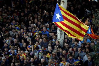 Supporters of independence waving an 'estelada,' the unofficial flag of Catalan separatists.