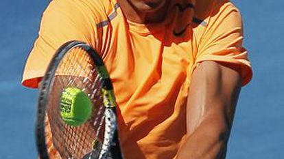 Nadal returns the ball on the new blue clay at the Madrid Open on Wednesday.