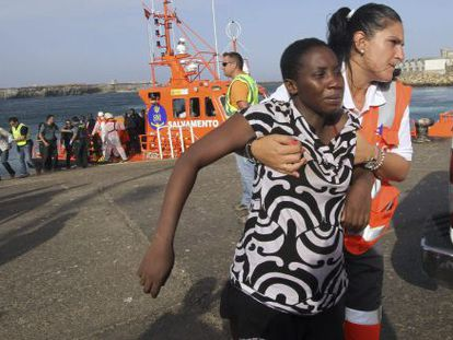 A would-be immigrant is helped ashore at the port of Tarifa, southern Spain, this week.