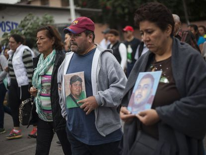 Families of the missing youths hold a vigil in Veracruz.