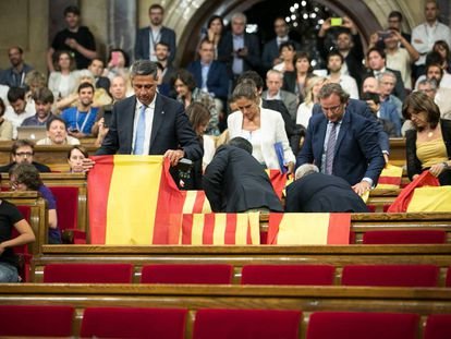 Spanish and Catalan flags inside the regional parliament on Wednesday.