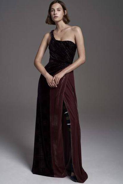 A models showcases Carolina Herrera's evening wear collection.