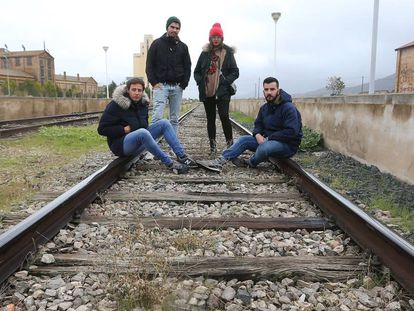 Four youngsters from Llerena, Badajoz, hang out on the oldest rail tracks in Spain. The tracks date back to the 19th century and are made from wood.