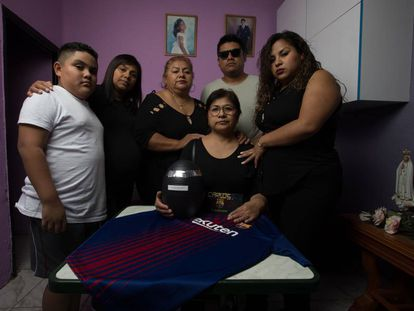 The family of Carlos Alberto Perry Carbajal stand with his ashes.