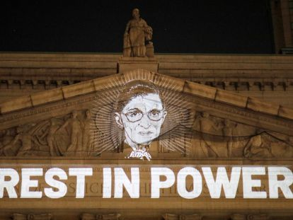 An image of Ruth Bader Ginsburg projected onto the New York State Civil Supreme Court building in Manhattan, New York City.