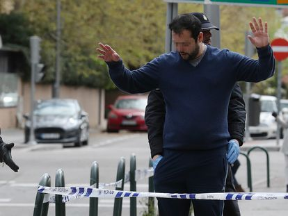 National Police officers in Madrid frisking a man who violated stay-at-home orders on March 24.