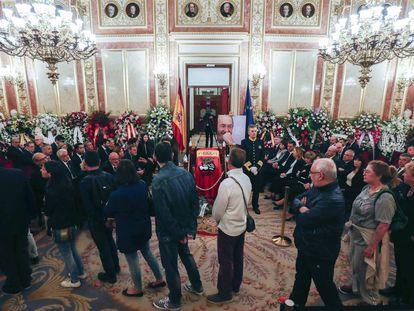 Members of the public file past Rubalcaba's casket on Saturday.