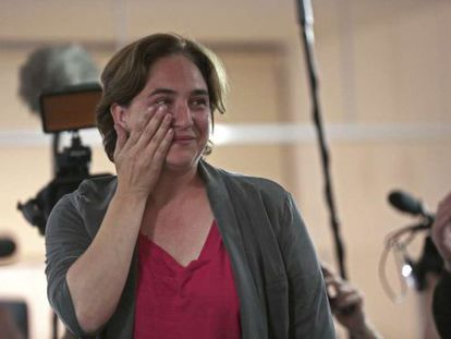 Ada Colau wipes a tear from her eye after winning the Barcelona mayoral race.
