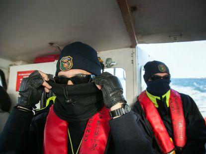Two customs officers on patrol along the Guadalquivir.