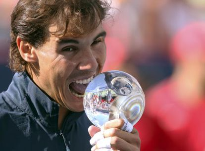 Nadal in Montreal with trophy number eight in 2013.