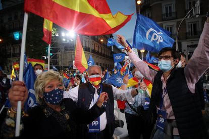 Supporters of the Popular Party celebrate the results outside the party's headquarters in Madrid.