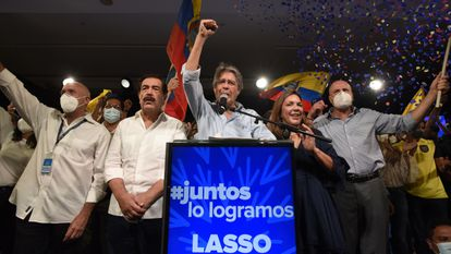 Guillermo Lasso celebrates his win in the Ecuadorian presidential elections on Sunday in Quito.