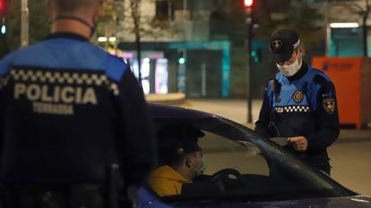 Police at a curfew checkpoint in the Catalan city of Terrassa on Sunday night.