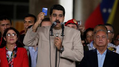 Nicolas Maduro holds up a copy of the Venezuelan Constitution.