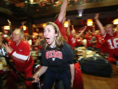 Wisconsin fans celebrate their team's victory in the semifinals.